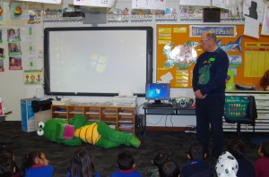 Cric Croc sleeps while author Anthony W Buirchell speaks to the IEC students about animals
