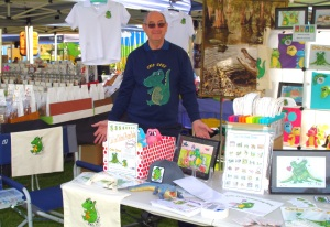 Anthony W Buirchell shows the range of Cric Croc merchandise at the Roleystone Markets